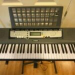 Yamaha EZ 220 Portable Keyboard with 61 Lighted Keys for Beginners